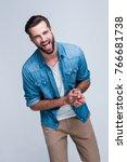 lol. handsome young man looking ... | Shutterstock . vector #766681738