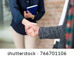handshake greeting on a job... | Shutterstock . vector #766701106
