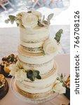 3 tier rustic wedding cake  | Shutterstock . vector #766708126