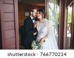 newlyweds embracing at the door ... | Shutterstock . vector #766770214