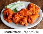 buffalo sauced chicken wings... | Shutterstock . vector #766774843