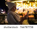 young woman using mobile phone... | Shutterstock . vector #766787758