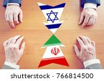 Small photo of Concept of confrontation between Iran and Israel. Diplomacy and hard talks