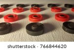 red and black round figures on... | Shutterstock . vector #766844620
