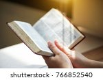 women reading from the holy... | Shutterstock . vector #766852540