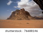 Solitary mountain in middle of the Wadi Rum desert - stock photo