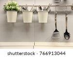 utensils on a kitchen wall | Shutterstock . vector #766913044