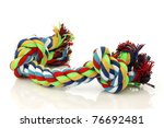 colorful cotton dog toy on a white background - stock photo