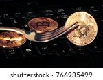 golden bitcoins with fork. hard ... | Shutterstock . vector #766935499