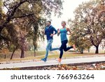 couple jogging and running... | Shutterstock . vector #766963264