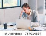 a frustrated man works behind a ... | Shutterstock . vector #767014894