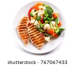 plate of grilled chicken with... | Shutterstock . vector #767067433