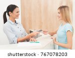 the dark haired woman works at... | Shutterstock . vector #767078203