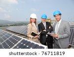 engineers checking solar panels ...
