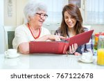grandmother and granddaughter... | Shutterstock . vector #767122678