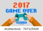 hands holding wireless gamepad  ... | Shutterstock .eps vector #767125420