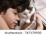 teenager boy and cat in cozy... | Shutterstock . vector #767170930