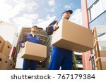 close up of two young delivery... | Shutterstock . vector #767179384