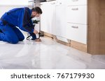 man spraying pesticide under... | Shutterstock . vector #767179930