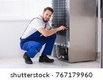 Photo Of Male Technician Fixin...