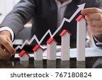 businessman holding paper graph ... | Shutterstock . vector #767180824