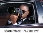 private detective sitting... | Shutterstock . vector #767181499