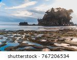 tanah lot is a rock formation... | Shutterstock . vector #767206534