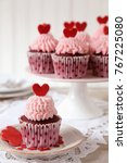 red velvet cupcakes decorated... | Shutterstock . vector #767225080