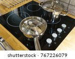 metal pot on induction hob in... | Shutterstock . vector #767226079