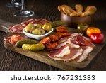a delicious charcuterie...   Shutterstock . vector #767231383
