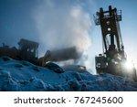 excavator in the mist in the... | Shutterstock . vector #767245600