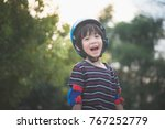 portrait of happy boy in blue... | Shutterstock . vector #767252779