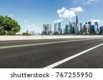 asphalt road and modern city... | Shutterstock . vector #767255950