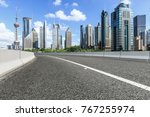 asphalt road and modern city... | Shutterstock . vector #767255974