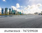 asphalt road and modern city... | Shutterstock . vector #767259028
