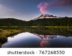reflection of the sunset over... | Shutterstock . vector #767268550