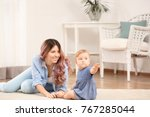 young mother with baby at home | Shutterstock . vector #767285044
