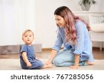 young mother with baby at home | Shutterstock . vector #767285056