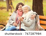 senior woman with cane and... | Shutterstock . vector #767287984