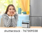 young woman listening to radio...   Shutterstock . vector #767309338