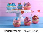 tasty bright cupcakes on color... | Shutterstock . vector #767313754