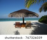 thatched parasol and two...   Shutterstock . vector #767326039