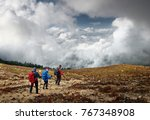 group hikers with backpacks... | Shutterstock . vector #767348908