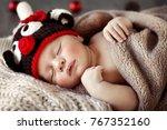 cute baby wearing reindeer hat... | Shutterstock . vector #767352160