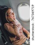 girl near the window in... | Shutterstock . vector #767369719