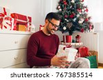 smiling young man holding... | Shutterstock . vector #767385514