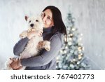 happy beautiful girl and dog... | Shutterstock . vector #767402773
