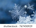 Snowflake On A Blue Background