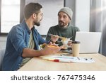 two bearded men cooperate for... | Shutterstock . vector #767475346