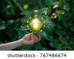 hand holding light bulb against ... | Shutterstock . vector #767486674